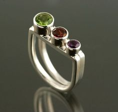 "Peridot Garnet and Amethsyt ""V"" shaped Sterling Silver ring. Handmade by Jen Lawler www.jenlawlerdesigns.etsy"