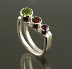 "Peridot Garnet and Amethsyt ""V"" shaped Sterling Silver ring. Handmade by Jen Lawler www.jenlawlerdesigns.etsy"