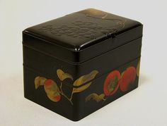 Two-Tiered Box with Design of Autumn Fruits Artist: Ikeda Taishin (Japanese, 1825–1903) Period: Meiji period (1868–1912) Date: second half of the 19th century Culture: Japan Medium: Lacquered wood with gold, silver, black, and red takamaki-e, hiramaki-e, and e-nashiji on black lacquer ground