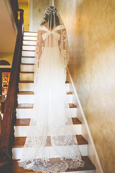 This bride's handmade veil is 80 years old! Her grandmother wore it and preserved it in the hopes that it would be passed on for generations to come — how sweet is that?