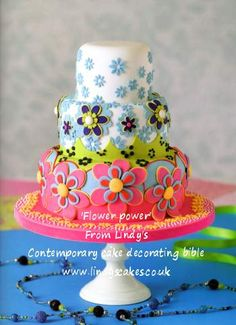 Flower power cutter cake from Lindy's 'contemporary cake decorating bible' book