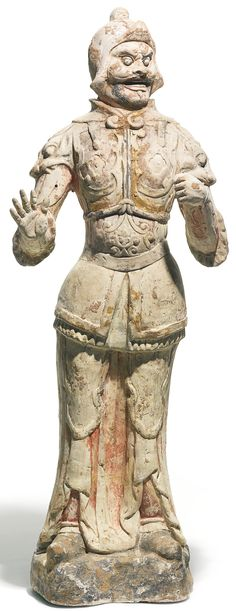 Chinese painted pottery figure of a Lokopala, Tang Dynasty, odelled standing on a rocky base wearing armour, the hands held to the front, the face with large bulbous eyes framed by a helmet, traces of gilt and polychrome decoration 77.5cm | Sotheby's