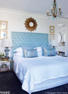 Designers Guild cushions and a custom-made diamond buttoned bedhead add glamour to interior designer Nellie Tilley's master bedroom.
