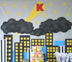 Silver sheet, use black fabric for the clouds. Get Yellow felt for stars and spot light. need Black paint.