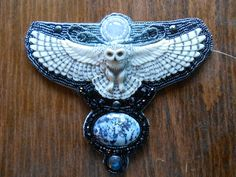 Laura Mears Owls | Porcelain owl-Laura Mears. Rainbow Moonstone and Dendritic opal, Etsy.I LOVE this piece.Snowy Owls are my favorite type of owl.
