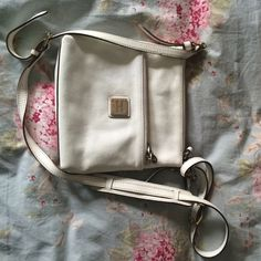 Dooney & Bourke letter carrier bag In like new condition. The insides are spotless. The bag is white with brown trim and gold hardware... Dooney & Bourke Bags Crossbody Bags