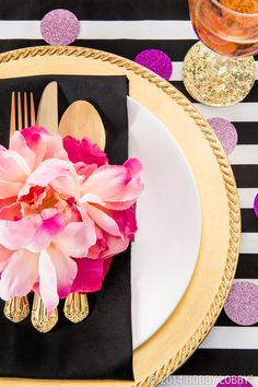 Don't limit your gold accessories to a neutral color scheme...this plate setting proves that bold black and bright fuchsia compliment gold in a beautiful way!
