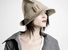 Claudia Schulz. A hood/cone, with light manipulation. #millinery #judithm #hats
