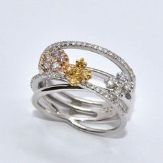 Here's another unique ring I found... Two-tone gold Diamond Ring.