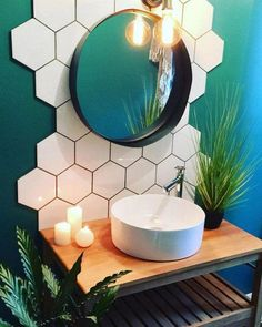 Bathroom interior design 421438477629749064 - Cool bathroom design with teal walls, hex tile backsplash and round mirror. Unusual tile installation and bright bold bathroom decor.
