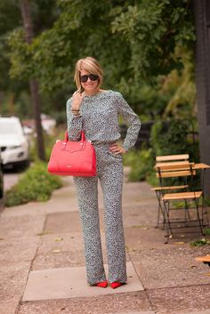 Usually I don't like jumpsuits, but this is COOL with the print, and I love how she paired it with matchy bright accessories.
