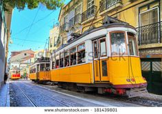 Beautiful image of the traditional yellow trams in Lisbon, Portugal. HDR - stock photo