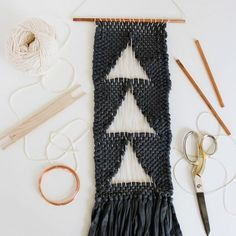 Learn how to make a negative space woven wall hanging. A fun project for a craft night!