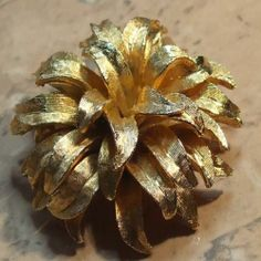 Golden layered vintage flower brooch with a cascade of gold coloured petals Impressive 1980s  vintage brooch of a chrysanthemum flower head