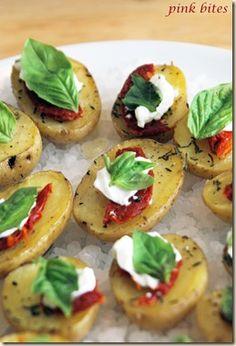 Roasted potato bites with sundried tomatoes and basil.