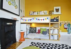 I like the banner on the bed!  IKEA HACKS | 2x2 Expedit under Kura bed with crib mattress