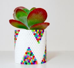This Beaded Planter is made repurposed from an ordinary Talenti gelato container. Check out the tutorial from Allison @zipper8lighting. http://thestir.cafemom.com/home_garden/186672/11_creative_ways_to_repurpose
