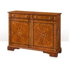 An exceptional rosewood, inlaid and brass strung side cabinet, the rectangular top above two frieze drawers with ovoid panel inlay, Medusa head brass handles and mounts to the radiating rosewood and banded cupboard doors enclosing an adjustable shelf, on bracket feet.