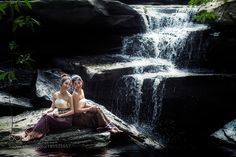 Two asian woman sitting alone at the waterfall by Pitakchatr