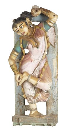 This carved and painted figure represents an apsara, the nymphs who serve as musicians and dancers at the court of Indra, the King of the Gods in Hindu, Buddhist and Jain mythology. Such figurines are often incorporated into the architectural program of Jain and Hindu temples as well as havelis or palatial mansions where they serve as symbols of welcome and prosperity.#Gujarat, #19thCentury