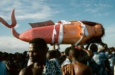 Africa | Coffin made and painted to resemble a mermaid for Ga tribal priestess of sea god carried by funeral guests. Teshie, Ghana | ©Universal Images Group