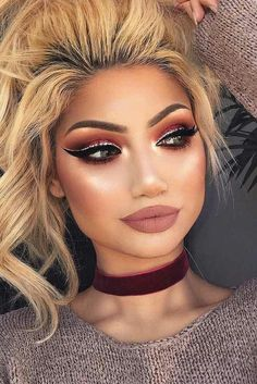 Nude lipstick dark and light brown and black eye shadow and glitter eye liner