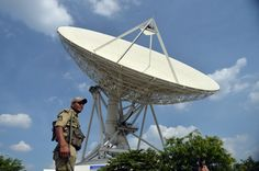 A Central Industrial Security Force (CISF) personnel stands guard in front of the 32-metre Dish Antennae at the Indian Space Research Organisation (ISRO