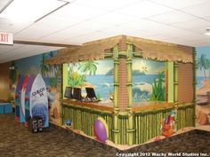 Wacky World Studios built a beach-themed check-in desk with realistic thatched wallcovering and surfboard check-in stations for Biltmore Baptist Church in North Carolina!