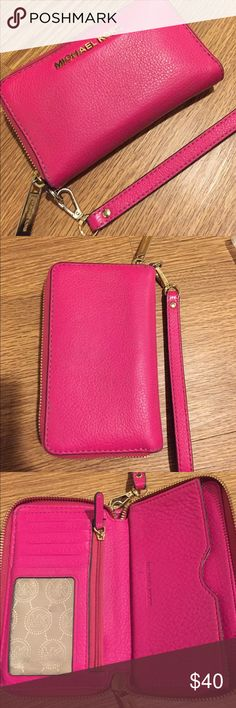 Michael Kors Jet Set Wallet Authentic fuschia pebble leather MK Jet Set Tech Wallet. Purchased last winter at Macy's and carried for a year. Overall good condition with a few small pen marks as shown in 4th pic. Super handy wristlet style. Holds my iPhone 6 perfectly. Gold tone hardware. MICHAEL Michael Kors Bags Wallets
