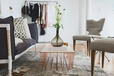 The New Man Repeller Office - A copper coffee table to match the copper chairs (also from Blu Dot). by Homepolish New York City https://www.homepolish.com/mag/the-new-man-repeller-office?gallerize=4be614d0