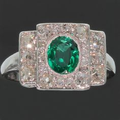 Art Deco platinum diamond engagement ring with emerald of exceptional quality