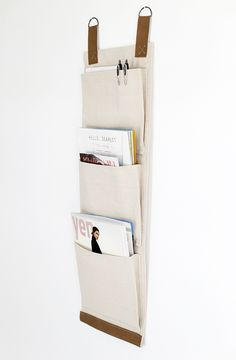 DIY Wall hanging Magazine or file holder from Home Free. Tutorial, simple sewing needed for this project made from canvas drop cloth.