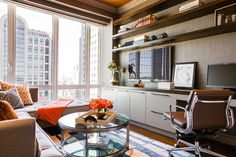 Custom built-in desk and floating shelves add to the functionality of this room, serving as both an office and a den.
