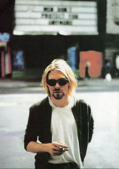 Kurt Cobain outside a cinema in New York, NY, US. July 24th, 1993 Photograph by Stephen Sweet