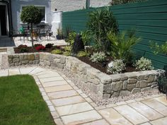 Exterior Great Stone Half Fences With Paver Block Cement Flooring And Green Garden As Decorate Landscaping Backyard Patio Ideas With Striking Inspirational Stone Patio Design Ideas For G
