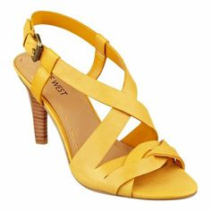 Minerva is a foot-flattering crisscross open toe sandal with adjustable buckle closure. Ready to take 9 to 5 by storm. Leather upper. Padded footbed for all-day comfort. Leather upper. Man-made lining and sole. Imported. Stacked 3 inch heels. Women's shoes.  Shop our entire collection of women's sandals.