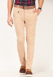 Stand out in the crowd for your fabulously dressing style wearing these beige coloured casual trousers from United Colors of Benetton. These corduroy trousers are made from cotton blend, which makes them light in weight and comfortable to wear. These slim-fit trousers can be best teamed with polo T-shirts.