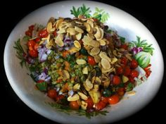 Salad of cooked mung beans and carrot, sauteed tomatoes with basil, garlic, olive oil and salt, topped with fresh mint, red onion and pan toasted almond flakes and fenugreek seeds!