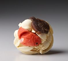 Netsuke of Fish and Octopus Ivory, coral, and tortoise shell