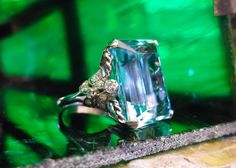 Breathtaking 1920's 23 carat aquamarine set in a beautiful diamond and platinum mounting.
