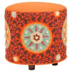 love this orange ottoman!