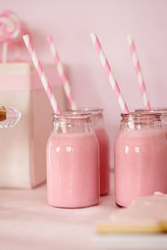 Gorgeously girly pink Strawberry Milkshakes with stripped straws.