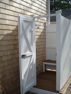 Here is the photo  of an outdoor shower made of AZEK, which is a cellular PVC beadboard. It looks and feels like wood, but it does not ever need to be painted. AZEK does not chip, crack or splinter and can take the salt water and cold New England temperatures. It is a fantastic product!