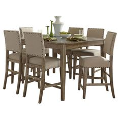 Gather friends and family for festive meals or everyday dinners with this country-chic dining set, showcasing a timeless weathered finish and nailhead-trimme...