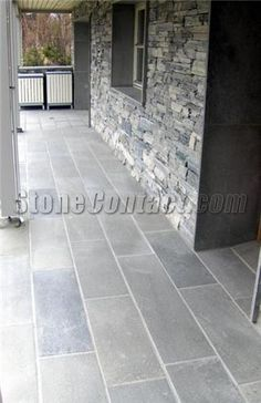 Slate floor tiles on the front porch. Awesome idea!