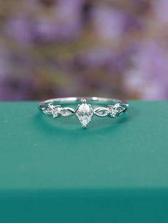 Art deco engagement ring Vintage engagement ring Marquise cut Antique Unique Simple Women wedding Diamond Bridal Jewelry Anniversary gift ◆Detail description◆ ◆Solid 14k White Gold(shown in picture) ◆Diamond Carat:0.14ct(main) Diamond Size:5*2.5mm(main) Diamond Clarity:VS-SI Diamond