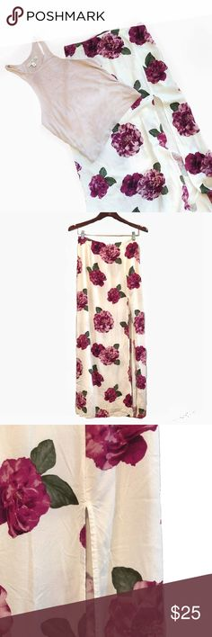 "F21 Floral Maxi Skirt F21 Floral Maxi Skirt * measurements listed below, size tag missing *  • Details :    - large dark, light purple + blush pink flower   - off white skirt    - side zip closure   - high slit up the front side   • Measurements :    Waist 13.5"" / Length 42""    Slit 28"" long ( starts 13"" below the waist )   • Material : 100% Rayon    • Condition : Excellent Forever 21 Skirts Maxi"