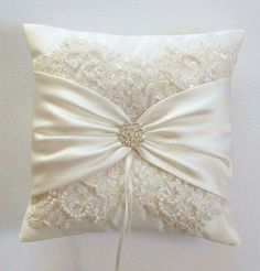How about this with antique lace instead of fancy lace? wedding rings cushion Wedding Pillow, Wedding Cushion, Lace Pillow, Ivory Satin and Beaded Alencon Lace, Ivory Satin Sash Cinched by Crystals - The MIRANDA Pillow Wedding Ring Cushion, Wedding Pillows, Cushion Ring, Cushion Pillow, Ring Bearer Pillows, Ring Pillows, Throw Pillows, Lace Pillows, Antique Lace