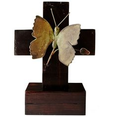 The Butterfly Cross, made of wood and iron, is a beautifully natural take on classic religious imagery. The  Barboglio butterfly is infused with color bringing this piece to life.The butterfly has a patina finish that is accentuated by the rustic wood.
