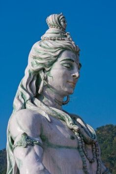 Lord Shiva statue profile blue sky